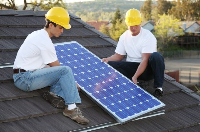 two electrician installing solar panels