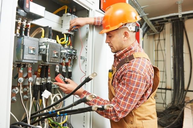electrician fixing an electrical panel