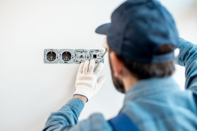 electrician fixing outlet