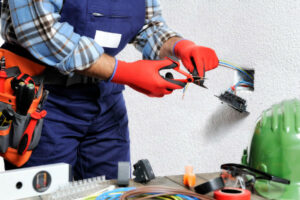 electrical professional uses safety gear while working