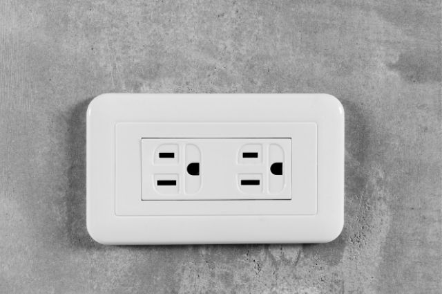 white gcfi outlet on the wall