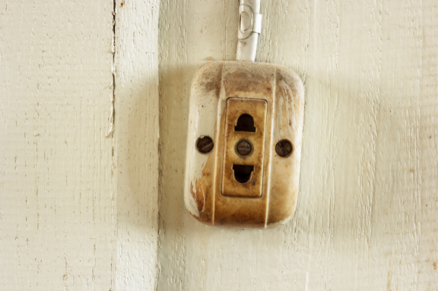 discoloration of old outlets is a sign you need to rewire your house